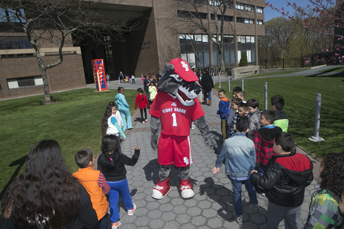 Wolfie greeting studentws